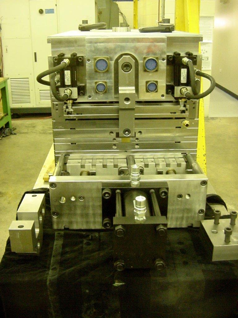 Injection molds with insert molding capabilities